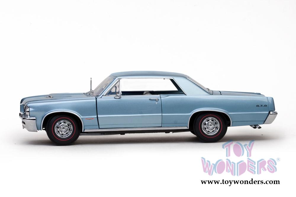 1964 Pontiac GTO en oro Sun Star escala 1:18 OVP nuevo